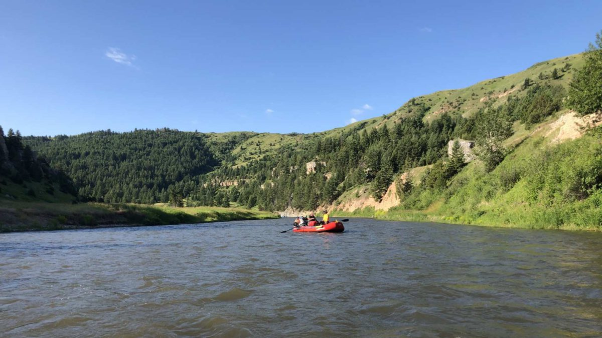 smith river montana with river raft and two men floating down the Smith River