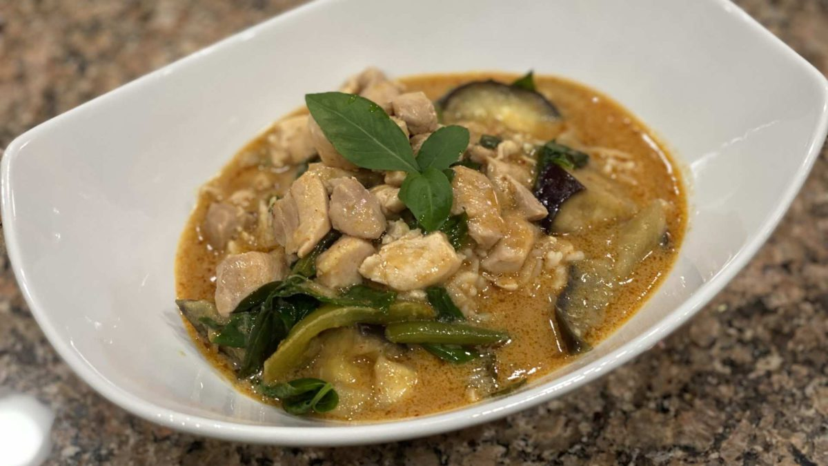 Bowl of panang thai curry with chicken. Includes Chicken, beans, eggplant, basil, and peanutbutter